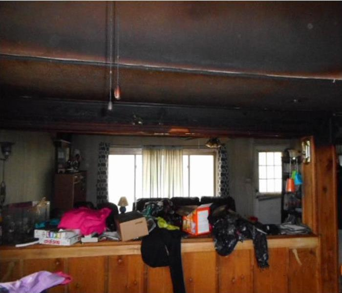 Fire damage in living room before restoration
