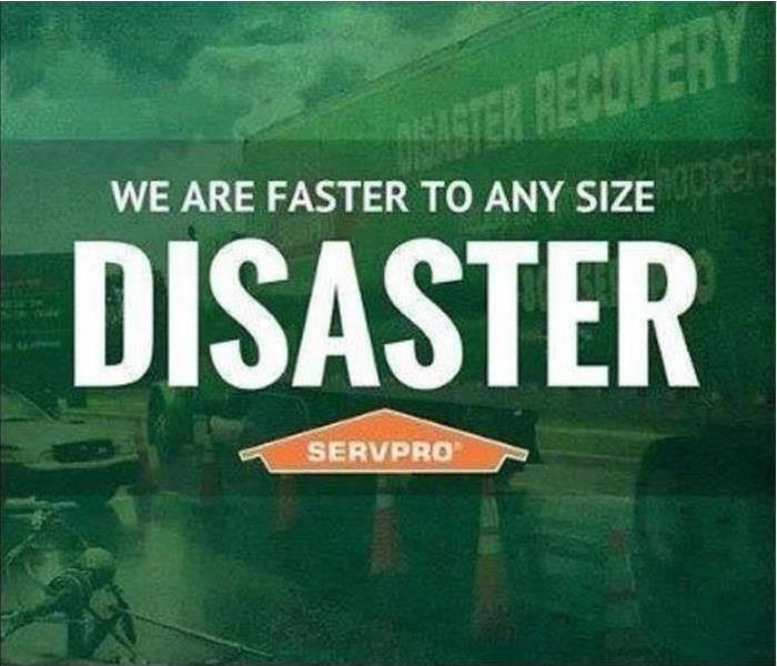 "SERVPRO semi outside of storm damaged property with ""We are faster to any size disaster"""