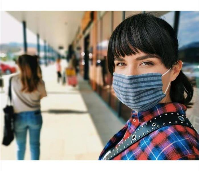 Woman wearing mask while shopping