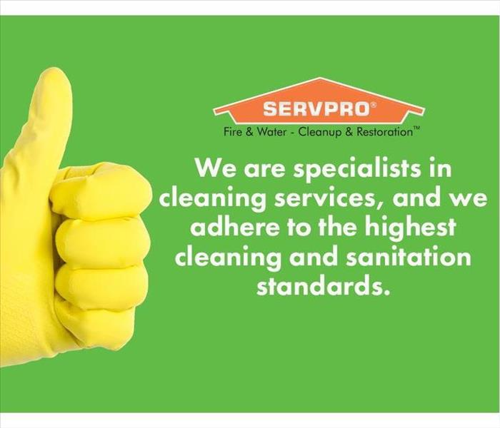Glove giving thumbs up with SERVPRO logo