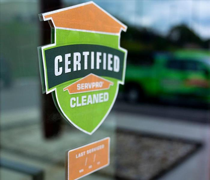 Certified: SERVPRO Cleaned window decal outside of business