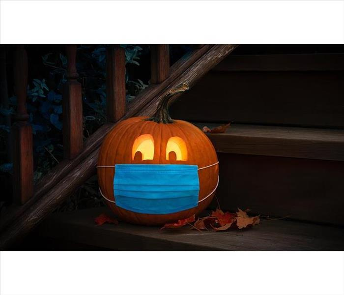 Jack-o-lantern with mask on